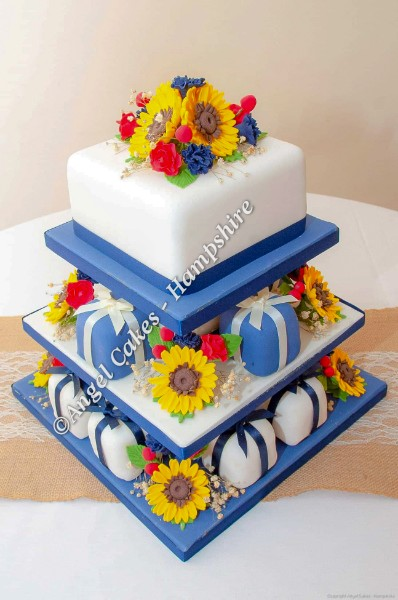 Mini Wedding Cakes in Navy with sunglowers